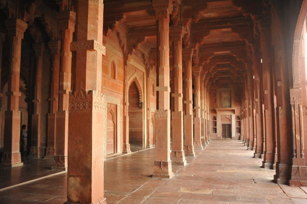 Hundreds of pillars support the long halls of the Jama Masjid