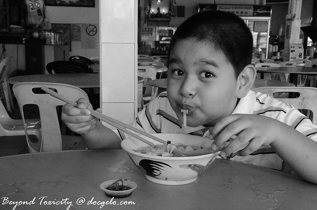 gabby enjoying his koay teow soup, raja uda, august 12, 2012