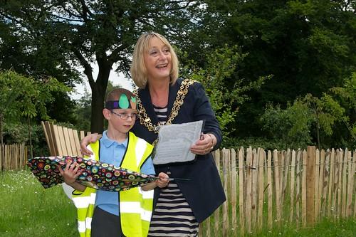 Mayor Brenda Warrington present prize to winner of best poem to a Flowery Field School pupil