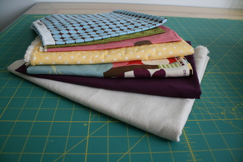 Stacks of fabrics for projects on the list