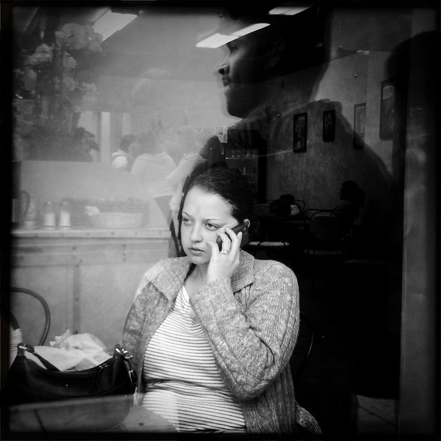 Someone on the phone in the Moscow & Tbilisi Bakery Store in San Francisco