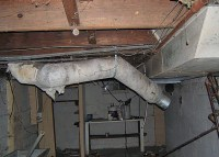 Home Heating Duct with Damaged Asbestos Paper Insulation ...