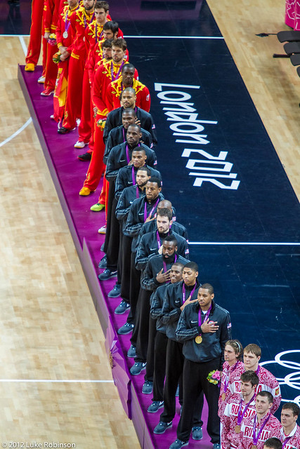 USA team, Olympic champions, stand for national anthem at medal ceremony, USA Spain Olympic Basketball Final, August 12th 2012
