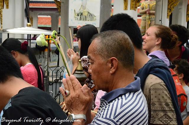 buddhist devotee grand palace bangkok