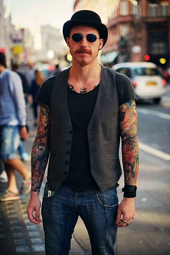 Man with colour sleeve tattoo