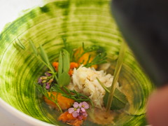 Pouring the broth: Brown crab, egg yolk and herbs