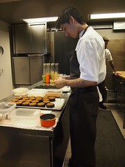 The lonely pastry chef prepping the butter dishes..