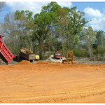 Construction vehicles moving around dirt