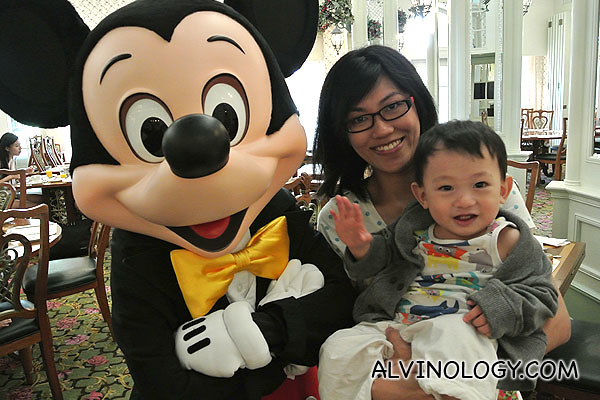 Rachel and son, Asher in Hong Kong Disneyland with Mickey Mouse