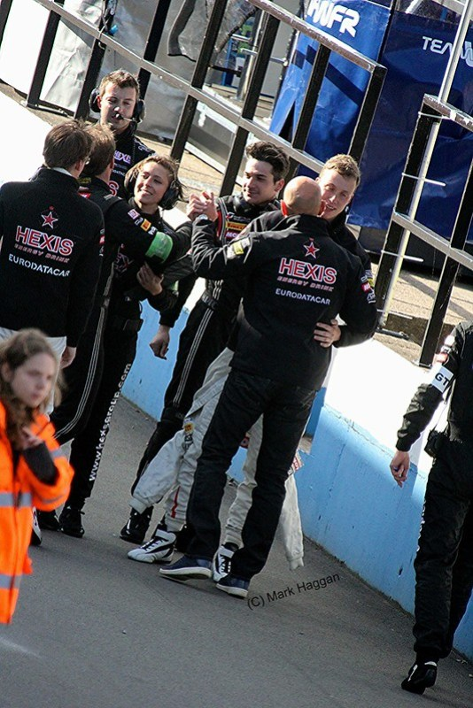 Celebrating a win in the pit lane