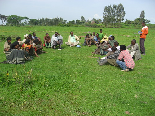 Community members from Limbichoch village discuss enclosure of grazing land with ILRI researcher