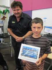 Summertime Reading Club winner Daniel with Mark of Paper Plus