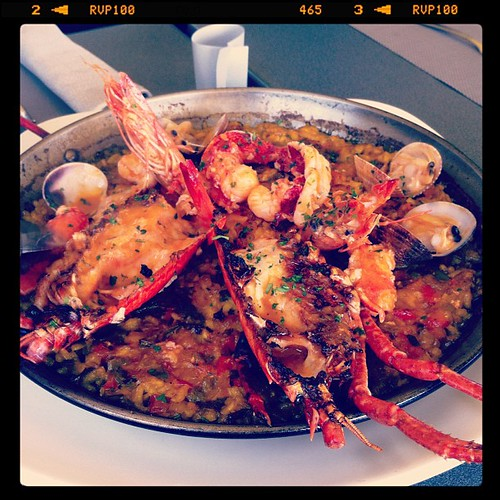 spanish baked rice with lobster, prawns, and clams