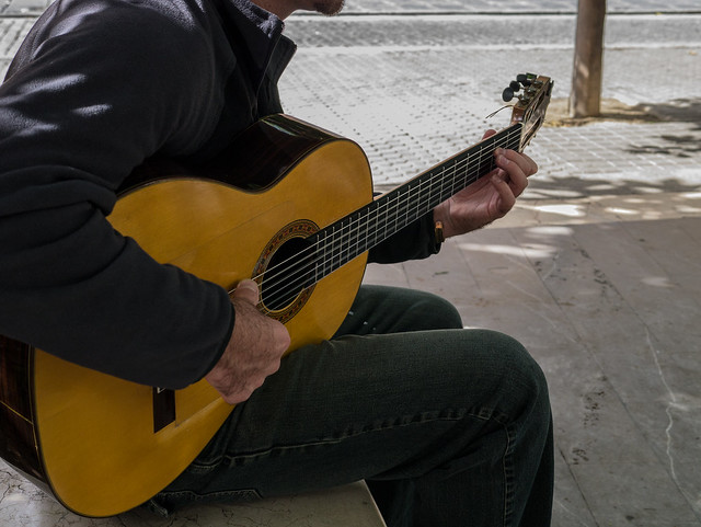 Guitar Man, poem by Chiew Pang