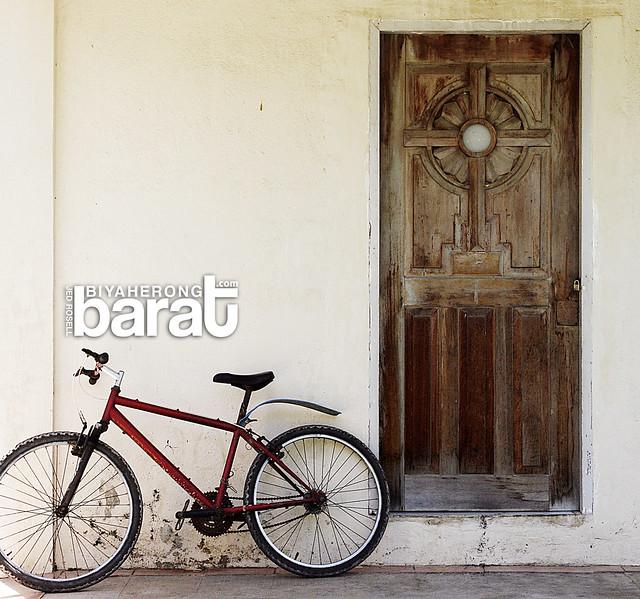 bike in a church in madridejos bantayan island cebu