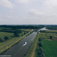 #flanders #landscape #boat #canal #vsco #vscocam #clouds #wanderlust #visitflanders #travel #travelgram #belgium #igbelgium #belgium_unite #green #summer #sky #aerialphotography
