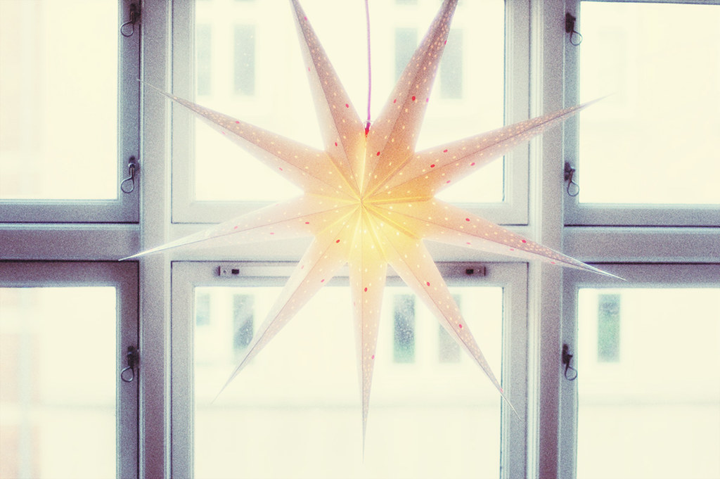 White paper star lantern in window