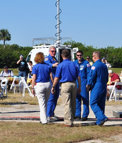 Astronaut Jon McBride (second from left) Greets STS-135 Crew During the Atlantis Rollout at Kennedy Space Center, Nov. 2, 2012