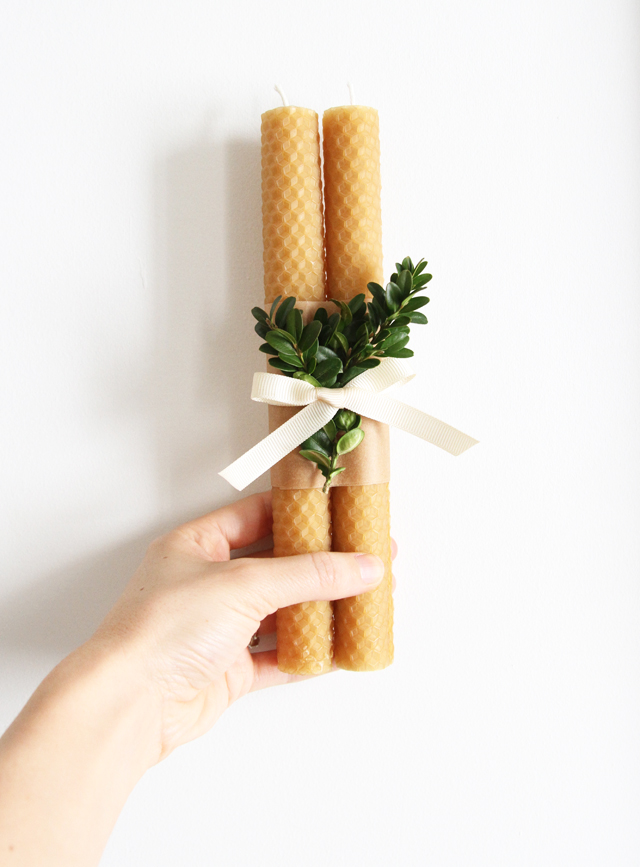 beeswax candle and boxwood