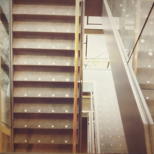 Looking down. I don't get what the purpose of the white dots are...#utm #library #stairs