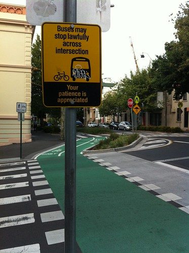 Buses may stop lawfully (and annoyingly) across intersection.