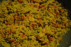 scampi met curry, worteltjes en erwten