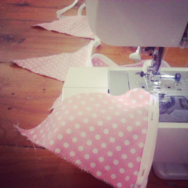 Sewing bunting for Miss Five's birthday picnic tomorrow.