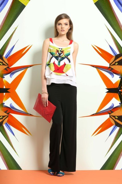 Layered tank top with birds of paradise print paired with black knit palazzo pants