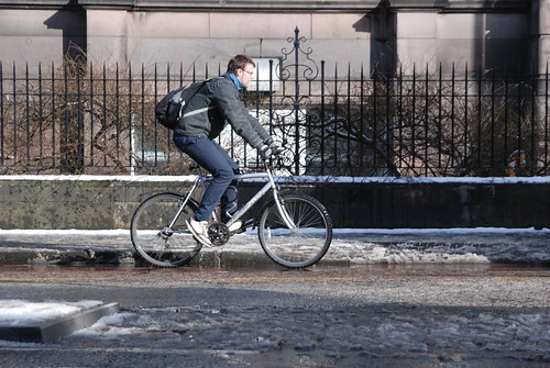 There may be snow on the ground, but people still cycle