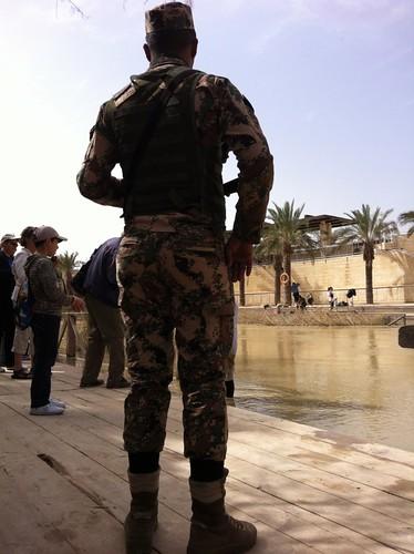 Jordanian Army guard staring at Israeli side of the Jordan River