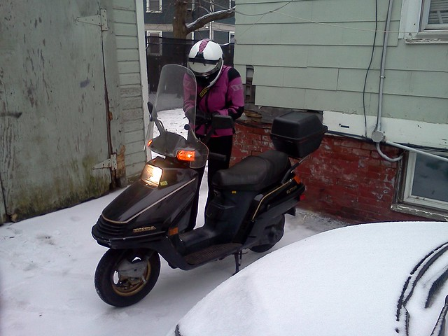 Getting ready to head out in the snow and cold -- love the Honda Elite 250