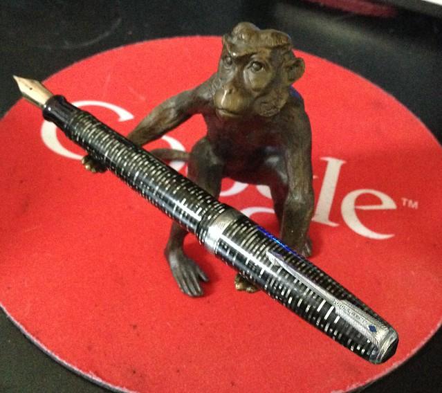 Pen monkey holds fountain pens