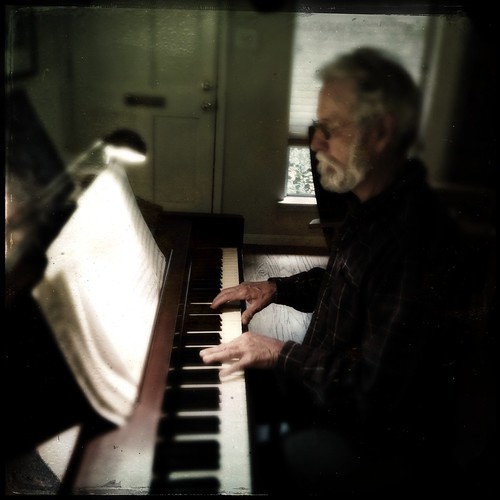 George playing the piano