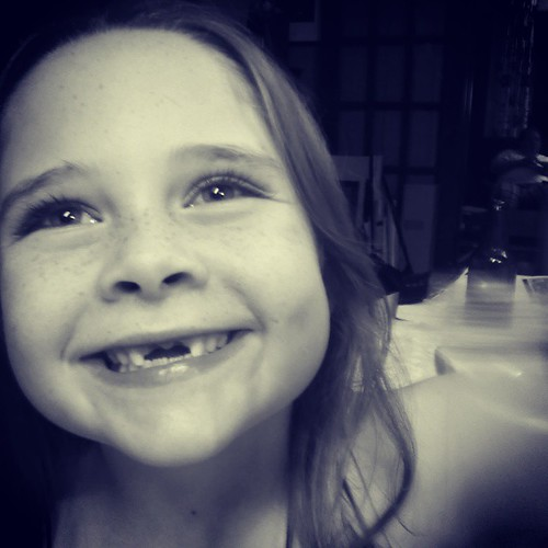 This girl! So scared for me to tug on it but so happy to have it out! #toothfairy