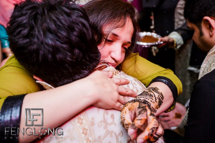 Groom's mother offering blessing during mehdni