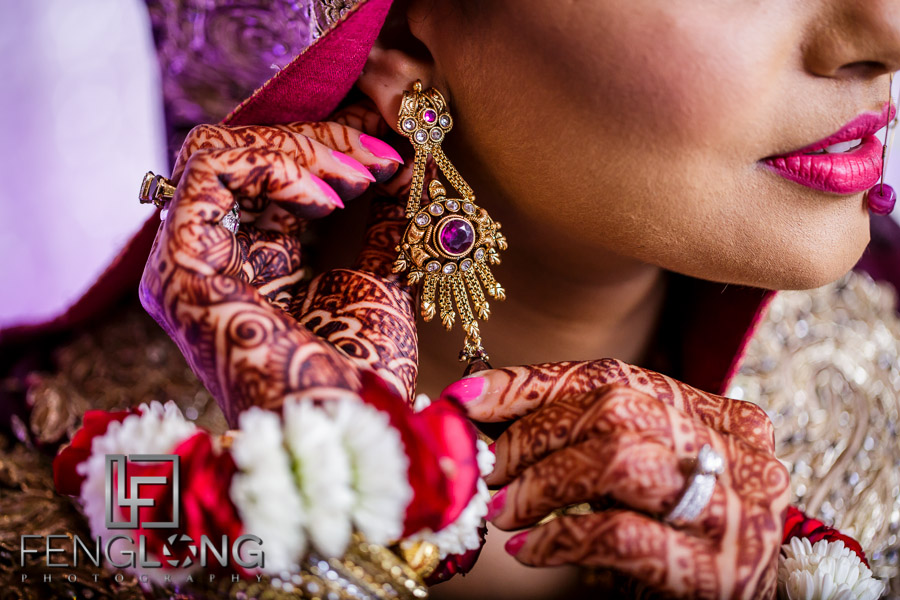 Close up of Indian bride's earrings on her wedding day