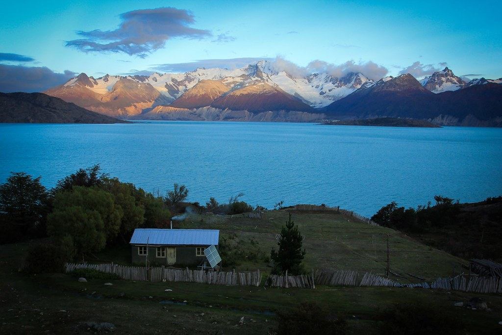Sun rises over the Cordon O'Higgins at the seccluded rancho of Don Lagos. Aysen. Patagonia. Chile.
