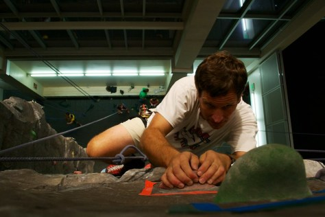 A student navigates our 3 story climbing wall