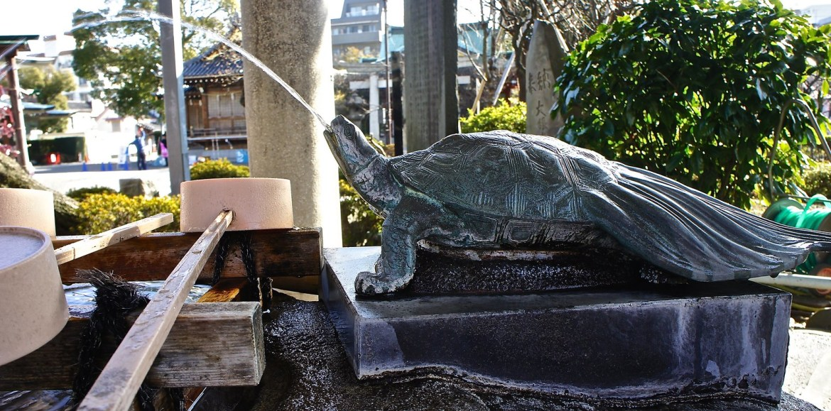 Turtle serving water at the Kameido Tenjin Shrine