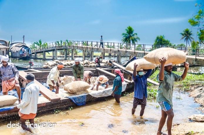men carrying rice sacks Book Kerala tour