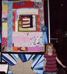Peyton and blue ribbon quilt