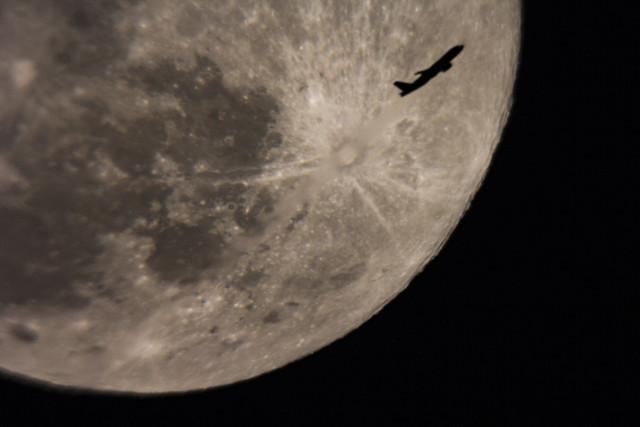 Plane photobombing the Full Moon