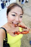 Tammi eating Filipino skewers