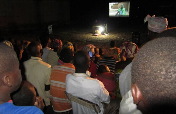 Members of a farming comunity in Sindalla Village, Mali during an evening video show on striga weed control
