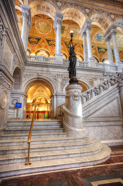 Grand Staircase with bronze statue of a woman holding an electric torch
