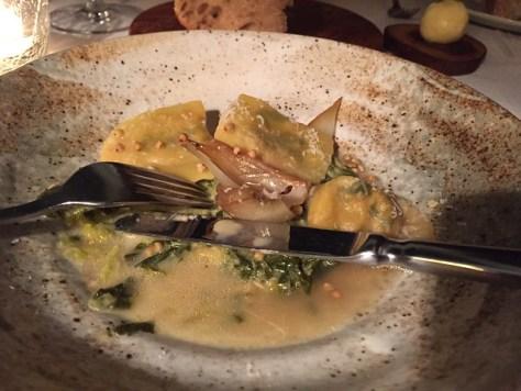 Ravioli of Italian greens, bouillon of smoked potato and roast onion.