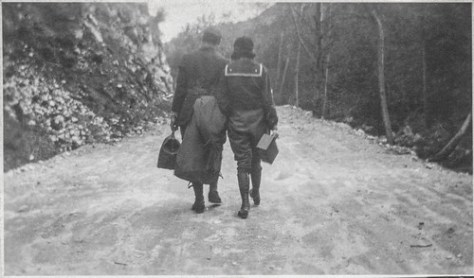 Couple walking away on a dirt road