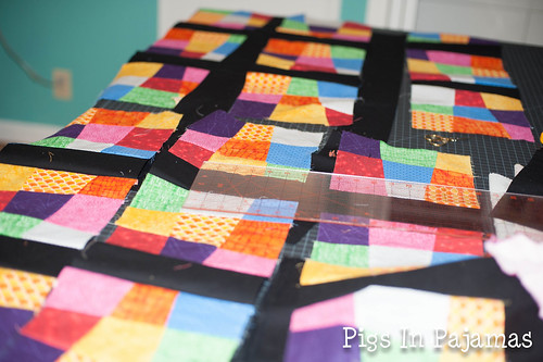 Laying out crazy 9 patch quilt top