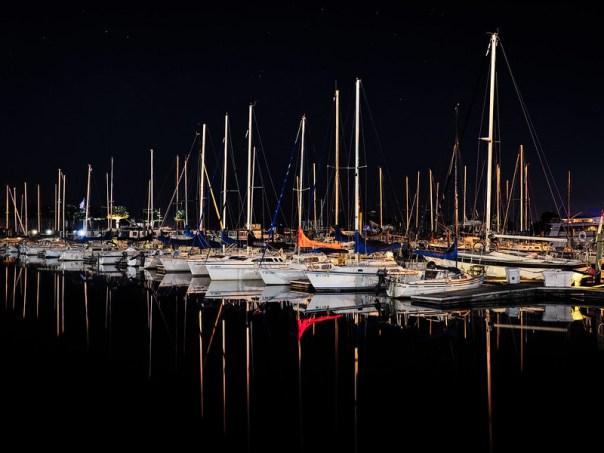 Still water, sailboats, and stars