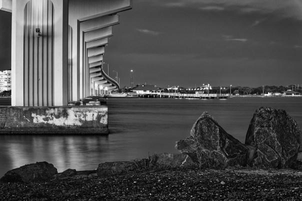 Beneath the bridge, by the rocks